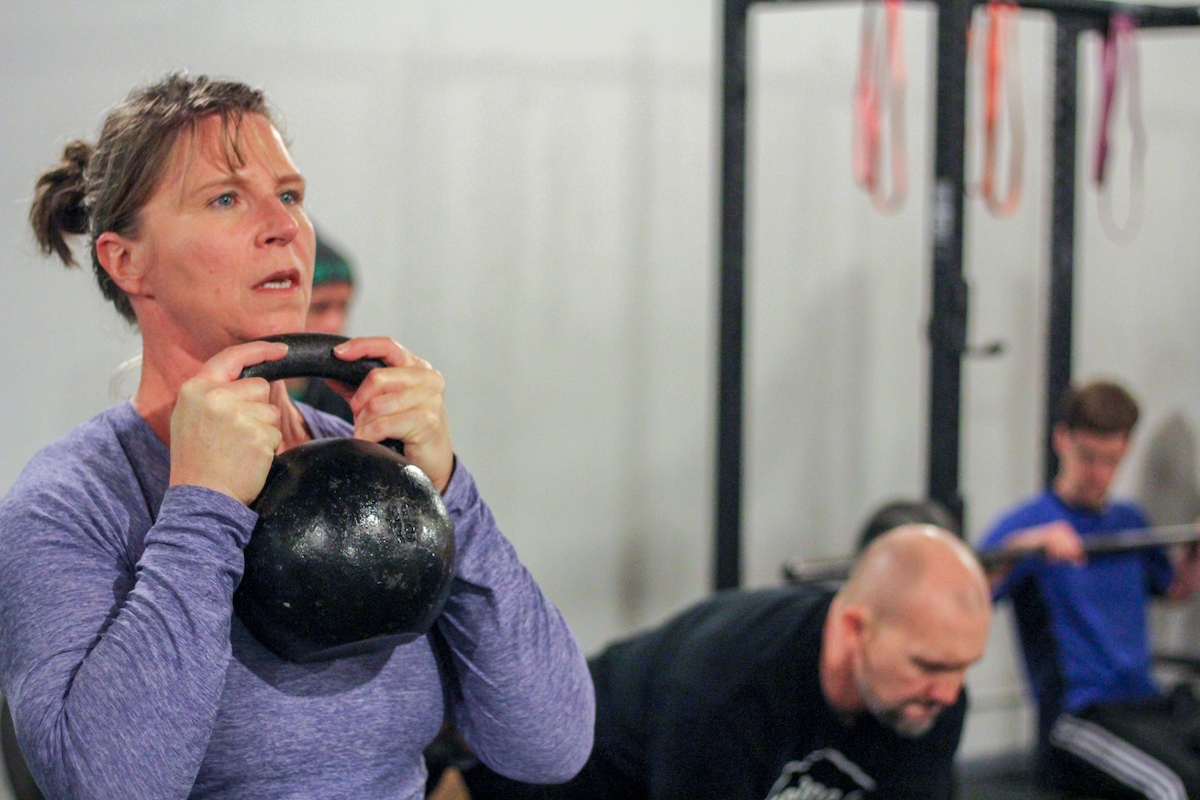 Jane lifting a kettlebell
